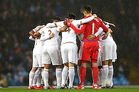 Swansea City players huddle ahead of the Barclays Premier League Match between Manchester City and Swansea City played at the Etihad Stadium, Manchester on 12th December 2015