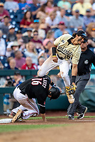 Vanderbilt Commodores third baseman Austin Martin (16) is upended by Louisville Cardinals baserunner Justin Lavey (16) during the NCAA College World Series on June 21, 2019 at TD Ameritrade Park in Omaha, Nebraska. Vanderbilt defeated Louisville 3-2 to head to the CWS Finals. (Andrew Woolley/Four Seam Images)