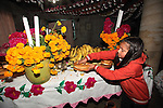 A Native nahuatl family puts an ofrenda on a table in their village of Acaxochitlan, in northern state of Hidalgo, during the festivities of the Day of the Deads. Hundreds of Native villages pay homage to their deads on the eve of November 2 as a tradition since the preHispanic times. Photo by Heriberto Rodriguez
