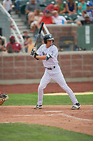 Brady McConnell (15) of the Idaho Falls Chukars at bat against the Orem Owlz at Melaleuca Field on July 14, 2019 in Idaho Falls, Idaho. The Owlz defeated the Chukars 6-2. (Stephen Smith/Four Seam Images)
