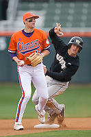 Micah Jarrett #2 of the Wake Forest Demon Deacons slides into second base as he and Brad Miller #13 of the Clemson Tigers look for the umpire's call at Doug Kingsmore stadium March 13, 2009 in Clemson, SC. (Photo by Brian Westerholt / Four Seam Images)