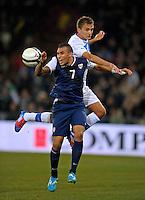 Danny Williams  (l, USA) vs. Domenico Criscito (ITA), during the friendly match Italy against USA at the Stadium Luigi Ferraris at Genoa Italy on february the 29th, 2012.