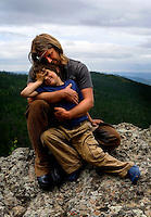 """Rupert Issacson, a campaigning writer and former horse trainer, embraces his five-year-old autistic son, Rowan, during a horseback expedition across Mongolia. Rowan, who has been nicknamed """"The Horse Boy"""", embarked on a therapeutic journey of discovery with his parents to visit a succession of shaman healers in one of the most remote regions in the world. Following Rowan's positive response to a neighbour's horse, Betsy, and some reaction to treatment by healers, Rowan's parents hoped that the Mongolian shamanistic rituals along the route and the prolonged contact with horses would help to unlock their son's autism and assist his development.."""