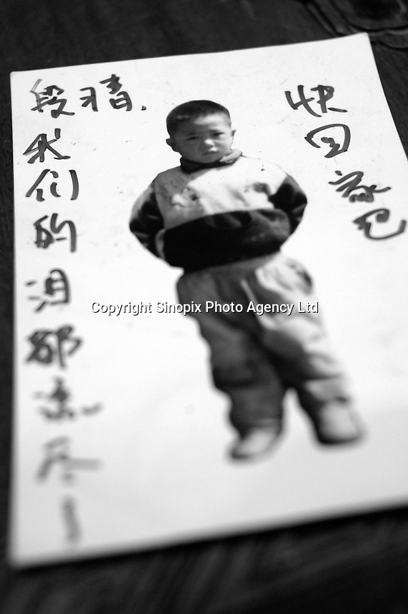 """Picture of a little boy, Duan Jing, 6.5 years old, lost in GuanDu district in Kumming city on 23 July 2003. Message from mother mrs Hua reads """"Duan Jing, we have ran out of tears. Please come home soon.""""..PHOTO BY SINOPIX"""