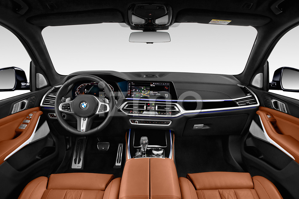 Stock photo of straight dashboard view of 2019 BMW X7 M-Sport 5 Door SUV Dashboard