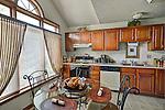 Commercial photo of condo kitchen interior.