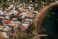 AJ2494, Dominica, Caribbean, Caribbean Islands, Aerial view of beachfront houses in Soufriere on the island of Dominica.