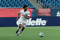 FOXBOROUGH, MA - JULY 9: Kosi Thompson #52 of Toronto FC II brings the ball forward during a game between Toronto FC II and New England Revolution II at Gillette Stadium on July 9, 2021 in Foxborough, Massachusetts.