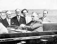 President F.D. Roosevelt in an open car by the Bahia Honda Bridge on February 19, 1939 Standing by the car are  John Coster, Alex Orr, C.C. Symonette, Mayor E.G. Sewell and Mark Byron,<br /> February 19, 1939