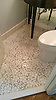 This custom bathroom floor features Jacqueline, a handmade floral mosaic shown in tumbled Thassos from the Silk Road Collection by Sara Baldwin for New Ravenna.<br />