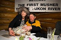 Millenium Hotel representative presents P.Gebhardt w/prize money @ *1st Musher to Yukon* Ruby