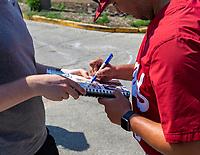 OMAHA, NE - JUNE 17: Fan autographs at practice at Creighton University on June 17, 2021 in Omaha, Nebraska.