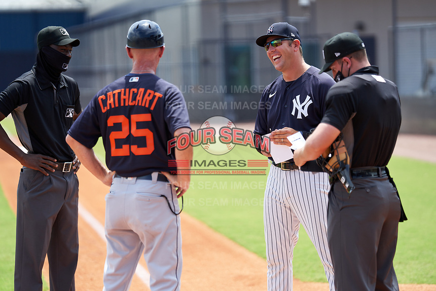 FCL Yankees manager Tyson Blaser (50) during the lineup exchange with Gary Cathcart (25) and umpires Felix Neon (left), Nelson Fraley (right) before a game against the FCL Tigers East on July 27, 2021 at the Yankees Minor League Complex in Tampa, Florida. (Mike Janes/Four Seam Images)