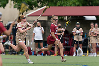 NEWTON, MA - MAY 16: Courtney Taylor #19 of Temple University brings the ball forward as Bridget Simmons #34 of Boston College closes during NCAA Division I Women's Lacrosse Tournament second round game between Temple University and Boston College at Newton Campus Lacrosse Field on May 16, 2021 in Newton, Massachusetts.