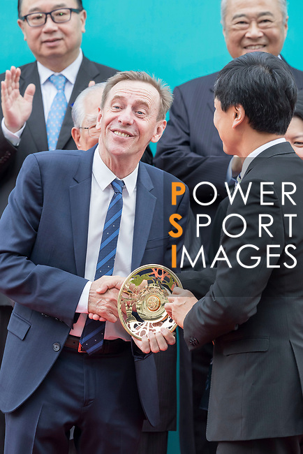 Horse trainer John Size receives a trophy after his horse Contentment won the Champions Mile (1600m) on 07 May 2017, at the Sha Tin Racecourse  in Hong Kong, China. Photo by Chris Wong / Power Sport Images