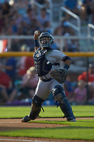 Danville Braves catcher Victor De Hoyos (34) makes a throw to first base against the Burlington Royals at Burlington Athletic Stadium on July 13, 2019 in Burlington, North Carolina. The Royals defeated the Braves 5-2. (Brian Westerholt/Four Seam Images)