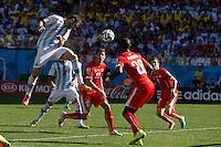 Gonzalo Higuain of Argentina heads the ball at goal