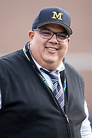 University of Michigan Athletic Director Warde Manuel takes in a Big Ten baseball game on April 13, 2018 in a Big Ten NCAA baseball game at Ray Fisher Stadium in Ann Arbor, Michigan. Michigan defeated Maryland 10-4. (Andrew Woolley/Four Seam Images)