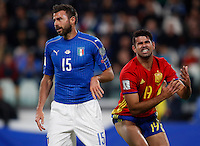 Spain Diego Costa, right, reacts past Italy Andrea Barzagli during the Fifa World Cup 2018 qualification soccer match between Italy and Spain at Turin's Juventus Stadium, October 6, 2016. The game ended 1-1.<br /> UPDATE IMAGES PRESS/Isabella Bonotto