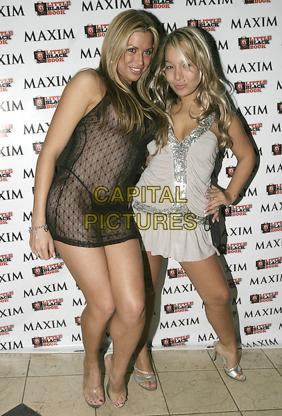 LOUISE GLOVER & DONATELLA.Maxim's Little Black Book,.Pascha London, Victoria, London, .February 17th 2005..Full length black lace sheer see-through see through thru mini dress hugging kissing grey silver dress pouting.Ref: AH.www.capitalpictures.com.sales@capitalpictures.com.©Capital Pictures.