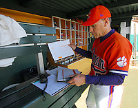 Clemson head coach Jack Leggett checks his paperwork prior to the game between the Mercer Bears and Clemson Tigers at Doug Kingsmore Stadium in Clemson, S.C. Photo by:  Tom Priddy/Four Seam Images