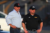 Feb 9, 2017; Pomona, CA, USA; NHRA funny car driver Phil Burkart (right) with team owner Robert Schwab during qualifying for the Winternationals at Auto Club Raceway at Pomona. Mandatory Credit: Mark J. Rebilas-USA TODAY Sports