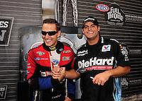 Nov. 13, 2011; Pomona, CA, USA; NHRA funny car driver Matt Hagan (right) and Bob Tasca III during the Auto Club Finals at Auto Club Raceway at Pomona. Mandatory Credit: Mark J. Rebilas-