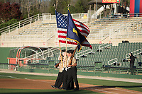 The Color Guard takes the field on Military Appreciation Night prior to the South Atlantic League game between the Lakewood BlueClaws and the Kannapolis Intimidators at Kannapolis Intimidators Stadium on April 7, 2017 in Kannapolis, North Carolina.  The BlueClaws defeated the Intimidators 6-4.  (Brian Westerholt/Four Seam Images)