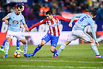 Angel Correa (c) of Atletico de Madrid fights for the ball with Jonathan Castro Otto, Jonny, of RC Celta de Vigo during their La Liga match between Atletico de Madrid and RC Celta de Vigo at the Vicente Calderón Stadium on 12 February 2017 in Madrid, Spain. Photo by Diego Gonzalez Souto / Power Sport Images