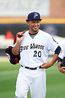 Pensacola Blue Wahoos pitcher Carlos Gonzalez (20) walks to the dugout after the second game of a double header against the Biloxi Shuckers on April 26, 2015 at Pensacola Bayfront Stadium in Pensacola, Florida.  Pensacola defeated Biloxi 2-1.  (Mike Janes/Four Seam Images)