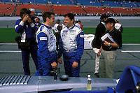 Johnny Mowlem (L) talks with teammate Tony Stewart on the grid. #2 Crawford...2002 Rolex 24 at Daytona, Daytona International Speedway, Daytona Beach, Florida USA Feb. 2002.(Sports Car Racing)