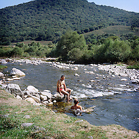 """Artur and Martar came with their friends for the celebration of one of their neighboors monument opening. After the celebration they decided to enjoy the rest of their sunny day by going swimming in the closest river and drinking """"to continue the celebration"""" they say."""