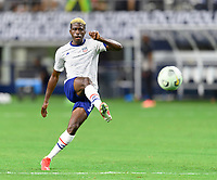 DALLAS, TX - JULY 25: Gyasi Zardes #9 of the United States warming up before a game between Jamaica and USMNT at AT&T Stadium on July 25, 2021 in Dallas, Texas.