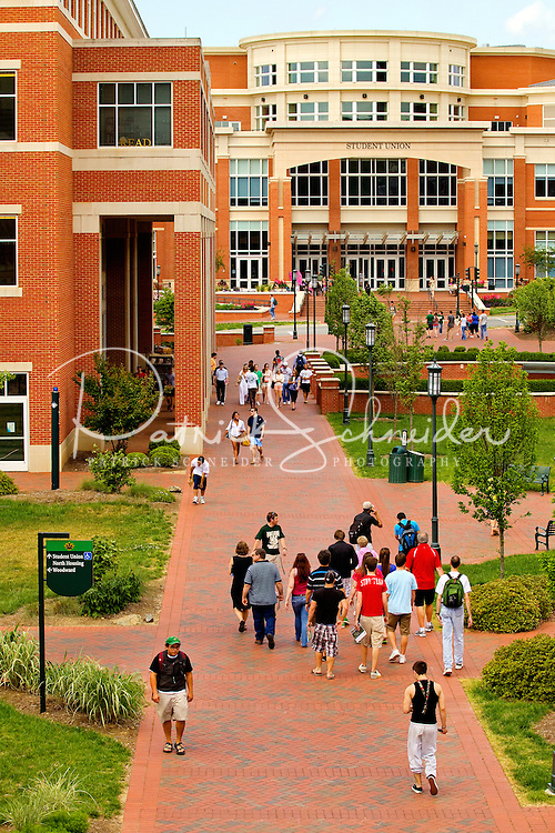 Photography of Charlotte NC's University of North Carolina at Charlotte campus (UNC Charlotte). UNCC, a public university located in northeast Charlotte, is part of the University of North Carolina higher education system. Opened in 1946, the campus has experienced explosive growth in recent years, including the addition of its Charlotte Research Institute campus and a football team. Photo shows the UNCC Student Union Building.