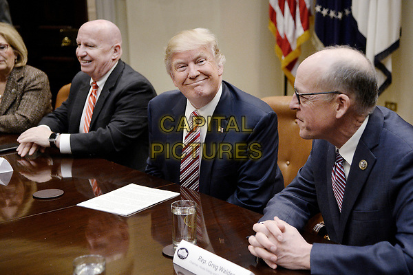 United States President Donald J. Trump speaks as US Representative Greg Walden (Republican of Oregon) Chairman of the US House Energy and Commerce Committee, right, and US Representative Kevin Brady (Republican of Texas), Chairman, US House Ways and Means Committee, left, look on during a discussion on healthcare  in the Roosevelt room of the White House on March 10, 2017 in Washington, DC. <br /> <br /> CAP/MPI/CNP/RS<br /> ©RS/CNP/MPI/Capital Pictures