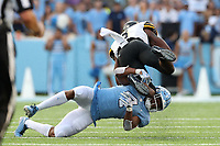CHAPEL HILL, NC - SEPTEMBER 21: Darrynton Evans #3 of Appalachian State University is tackled by Trey Morrison #4 of the University of North Carolina during a game between Appalachian State University and University of North Carolina at Kenan Memorial Stadium on September 21, 2019 in Chapel Hill, North Carolina.