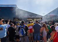 Apr 12, 2015; Las Vegas, NV, USA; Fans surround the pit of NHRA top fuel driver Doug Kalitta as he warms up his engine during the Summitracing.com Nationals at The Strip at Las Vegas Motor Speedway. Mandatory Credit: Mark J. Rebilas-