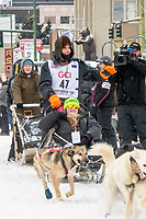 Jeremy Keller and team leave the ceremonial start line with an Iditarider and handler at 4th Avenue and D street in downtown Anchorage, Alaska on Saturday March 7th during the 2020 Iditarod race. Photo copyright by Cathy Hart Photography.com