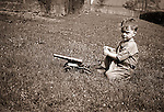 Wilkinsburg PA: Brady Stewart Jr. playing with a toy cannon.