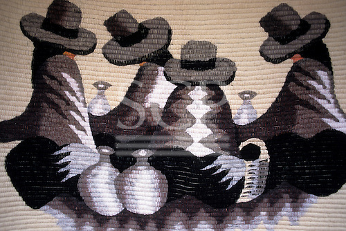 Cusco, Peru. Modern woven rug with stylised representation of a group of Quechua Indians with stoneware pots.