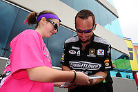 Apr. 15, 2012; Concord, NC, USA: NHRA funny car driver Jack Beckman signs an autograph during the Four Wide Nationals at zMax Dragway. Mandatory Credit: Mark J. Rebilas-