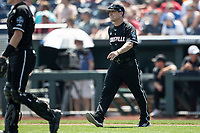 Louisville Cardinals head coach Dan McDonnell (3) heads to the mound during Game 3 of the NCAA College World Series against the Vanderbilt Commodores on June 16, 2019 at TD Ameritrade Park in Omaha, Nebraska. Vanderbilt defeated Louisville 3-1. (Andrew Woolley/Four Seam Images)