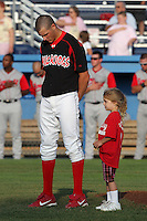 """Batavia Muckdogs pitcher Kevin Siegrist with a """"fan of the game"""" before a game vs. the Lowell Spinners at Dwyer Stadium in Batavia, New York July 14, 2010.   Batavia defeated Lowell 12-2.  Photo By Mike Janes/Four Seam Images"""