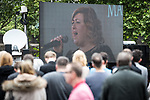 © Joel Goodman - 07973 332324 . 30/06/2017 . Stockport , UK . Crowds in the street outside the Town Hall watch the service and Michelle McManus singing , on a big screen . The funeral of Martyn Hett at Stockport Town Hall . Martyn Hett was 29 years old when he was one of 22 people killed on 22 May 2017 in a murderous terrorist bombing committed by Salman Abedi, after an Ariana Grande concert at the Manchester Arena . Photo credit : Joel Goodman