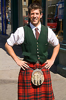 Young attractive local man in traditional kilt in capital of Edinburgh Scotland