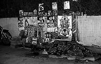 12.2010 Varanasi (Uttar Pradesh)<br /> <br /> Monkey with man sleeping in the street with god and goddess images behind him.<br /> <br /> Un homme et un singe dormant dans la rue avec des images de dieux et déesses dèrrière lui.