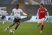 21st November 2020; Liberty Stadium, Swansea, Glamorgan, Wales; English Football League Championship Football, Swansea City versus Rotherham United; Jamal Lowe of Swansea City crosses the ball as Ben Wiles of Rotherham United closes in from behind