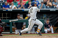 Michigan Wolverines outfielder Jordan Brewer (22) follows through on his swing during Game 1 of the NCAA College World Series against the Texas Tech Red Raiders on June 15, 2019 at TD Ameritrade Park in Omaha, Nebraska. Michigan defeated Texas Tech 5-3. (Andrew Woolley/Four Seam Images)