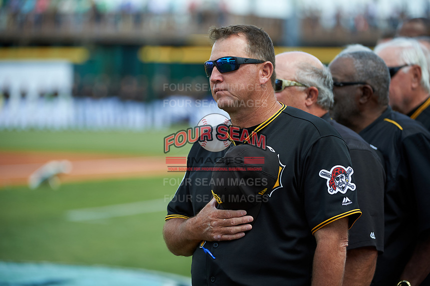 Pittsburgh Pirates coach Tom Prince (14) stands for the national anthem before a Grapefruit League Spring Training game against the New York Yankees on March 6, 2017 at LECOM Park in Bradenton, Florida.  Pittsburgh defeated New York 13-1.  (Mike Janes/Four Seam Images)