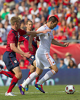 USA defender   Tim Ream (15) closes as Spain forward Alvaro Negredo (22) drives for the net and scores. In a friendly match, Spain defeated USA, 4-0, at Gillette Stadium on June 4, 2011.